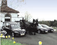 Jaguar hearse and limousine and horse drawn hearse